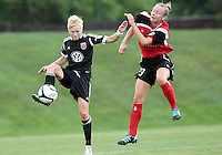 BOYDS, MARYLAND - July 21, 2012:  Joanna Lohman (17) of DC United Women controls the ball in front of Jamie Clark (23) of the Virginia Beach Piranhas during a W League Eastern Conference Championship semi final match at Maryland Soccerplex, in Boyds, Maryland on July 21. DC United Women won 3-0.