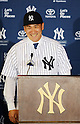 Masahiro Tanaka attends a press conference after signing with the New York Yankees