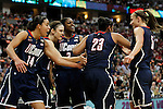 01 APRIL 2012:  University of Connecticut teammates congratulate Kaleena Mosqueda-Lewis (23) after taking a charge against the University of Notre Dame during the Division I Women's Final Four Semifinals at the Pepsi Center in Denver, CO.  Notre Dame defeated UCONN 83-75 to advance to the national championship game.  Jamie Schwaberow/NCAA Photos