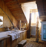 Wood clad bath in a room under the eaves
