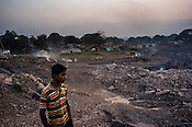 Methane gas rises from the ground in Lantengunj in Jharia, outside of Dhanbad in Jharkhand, India.  Photo: Sanjit Das/Panos