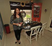 NWA Democrat-Gazette/MICHAEL WOODS &bull; <br /> Jessica Leonard at her kitchen table Saturday December 12, 2015 at her Fayetteville home.