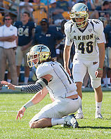 Akron placekicker Robert Stein (48) and holder Zach D'Orazio await the snap. The Akron Zips Defeated the Pitt Panthers 21-10 at Heinz Field, Pittsburgh. Pennsylvania on September 27, 2014.