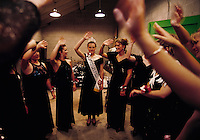 """The Minnesota State Fair's outgoing Princess Kay of the Milky Way, Kimberly Mallory, reviews the infamous """"wave"""" with pageant contestants. Only daughters whose parents operate dairy farms, or work on them, are eligible to become county, then regional, dairy princesses."""