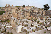 CORINTH, GREECE - APRIL 16 : A detail of the ruins of North Basilica, on April 16, 2007 in Corinth, Greece.The North Basilica, a large hall divided by two rows of columns with chambers at each end, may have used for public meetings. Its ruins, near the Temple of Apollo, are seen here in the early morning light. Corinth, founded in Neolithic times, was a major Ancient Greek city, until it was razed by the Romans in 146 BC. Rebuilt a century later it was destroyed by an earthquake in Byzantine times. (Photo by Manuel Cohen)