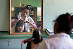 Students participate in a hair styling class at the Instituto de Buena Voluntad (the Good Will Institute) in Montevideo, Uruguay. Sponsored by the Methodist Church of Uruguay, the institute receives financial support from United Methodist Women.