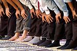Muslim men stop to pray alongside a street in Lahore, Pakistan. The country has a Muslim majority.