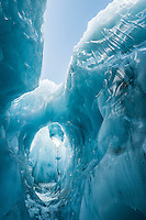 Amazing blue ice tunnel, cave on Franz Josef Glacier, Westland National Park, West Coast, World Heritage Area, South Westland, New Zealand