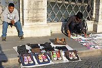 Venditori ambulanti.Itinerant seller...