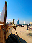 """A dhow (Arabic,???) is a traditional Arab sailing vessel with one or more lateen sails. They are primarily used along the coasts of the Arabian Peninsula, Pakistan, India, and East Africa. Larger dhows have crews of approximately thirty, while smaller dhows typically have crews of around twelve..Up to the 1960s, dhows made commercial journeys between the Persian Gulf and East Africa using sails as their only means of propulsion. Their cargo was mostly dates and fish to East Africa and mangrove timber to the lands in the Persian Gulf. They sailed south with the monsoon in winter or early spring and back again to Arabia in late spring or early summer. The term """"dhow"""" is also applied to small, traditionally-constructed vessels used for trade in the Red Sea and the Persian Gulf area and the Indian Ocean from Madagascar to the Gulf of Bengal. Such vessels typically weigh 300 to 500 tons, and have a long, thin hull design. Also, it is a family of early Arab ships that used the lateen sail, on which the Portuguese likely based their designs for the caravel known to Arabs as sambuk, booms, baggalas, ghanjas, and zaruqs."""