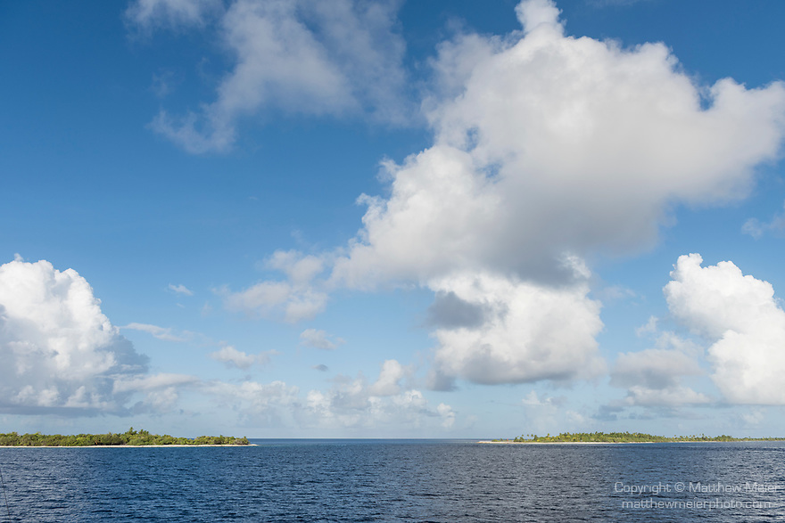 Kauehi Atoll, Tuamotu Archipelago, French Polynesia; view of Arikitamiro Pass with blue sky and cloud formations above