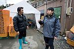 Takeshi Tachibana (R) and Hiromitsu Ito of Oh! Guts! stand next to the temporary fishing facilities in Ogatsu, Ishinomaki, Miyagi Prefecture, Japan on 01 Dec 2011. .Photographer: Robert Gilhooly