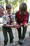 Boy scout making fire