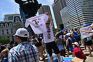 """Philadelphia, PA - July 26, 2016: A man sells t-shirts that read """"Ring in the Political Revolution at a """"Bernie or Bust"""" rally across from City Hall during the Democratic National Convention in Philadelphia, PA, July 26, 2016  (Photo by Don Baxter/Media Images International)"""