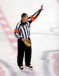 10 April 2010: NHL referee Dan Marouelli stands at center ice prior to his last career game officiating the final game of the regular season between the Toronto Maple Leafs and the Montreal Canadiens at the Bell Centre in Montreal, Quebec, Canada. The Leafs defeated the Habs 4-3 in sudden death overtime as the Canadiens advance to the Stanley Cup Playoffs with the single point. Mandatory Credit: Ed Wolfstein Photo