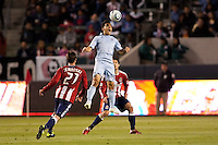 Sporting Kansas City DP forward Omar Bravo (99) leaps high for a headball. Sporting KC defeated CD Chivas USA 3-2 at Home Depot Center stadium in Carson, California on Saturday March 19, 2011...