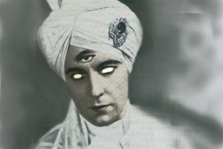 A young man wearing a turban with three eyes