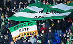 St Johnstone v Celtic.....26.12.13   SPFL<br /> Celtic fans with flags and banners<br /> Picture by Graeme Hart.<br /> Copyright Perthshire Picture Agency<br /> Tel: 01738 623350  Mobile: 07990 594431