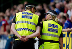 St Johnstone v Rangers... 30.07.11   SPL Week 2.Officers from the Anti-Sectarium Initiative keeping watch on the Rangers fans.Picture by Graeme Hart..Copyright Perthshire Picture Agency.Tel: 01738 623350  Mobile: 07990 594431