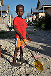 A boy pauses in a street in Camp Corail, a controversial resettlement of earthquake survivors north of Port-au-Prince, Haiti. Thousands of families were relocated to Corail from flood-prone areas of the capital in 2010, yet the promises of jobs that lured them there failed to materialize.
