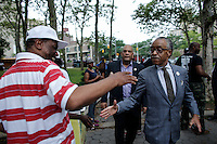 Rev Al Sharpton salutes as he arrives to attend a rally for the first anniversary of the death of Eric Garner in Brooklyn New York 07/18/2015. Kena Betancur/VIEWpress