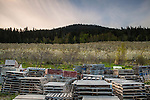 Stacks of pallets sit idle near a cherry orchard in early May as they wait to be filled with cherries that will be picked later in the season.
