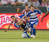 CARSON, CA – June 18, 2011: Chivas USA forward Marcos Mondaini (23) and FC Dallas defender Zach Loyd (19) during the match between Chivas USA and FC Dallas at the Home Depot Center in Carson, California. Final score Chivas USA 1, FC Dallas 2.