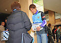 March 22, 2011, Kawasaki City, Kanagawa Prefecture, Japan - Professional soccer players from Kawasaki Frontale, a J-League soccer team from Kawasaki, Kanagawa Prefecture, Japan, pitch in at Kawasaki Station to gather donations for survivors of the 2011 Tohoku-Kanto Natural Disaster. The J-League season will be paused for a month and a half due to damage sustained in the earthquakes and tsunamis. (Photo by Atsushi Tomura/AFLO)