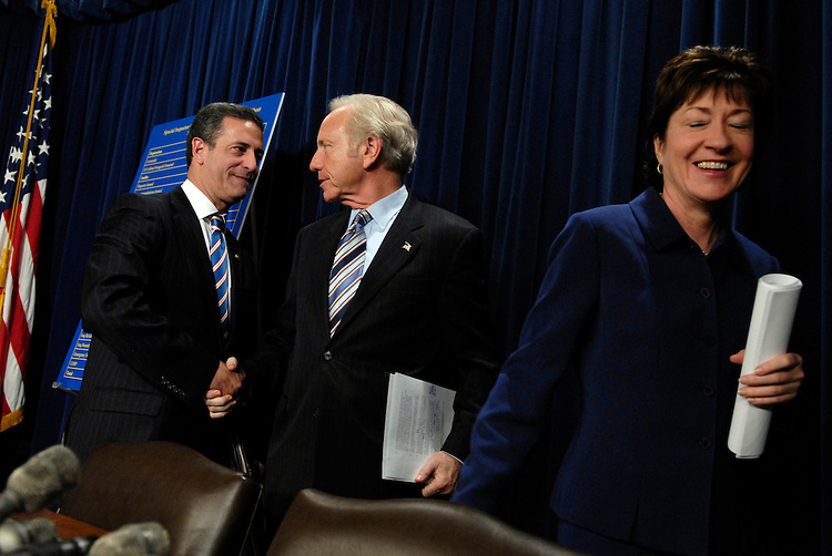 From left, Sens. Russ Feingold, D-Wis., Susan Collins, R-Me., and Joe Lieberman, I-Conn., leave a news conference of the Iraq reconstruction bill.