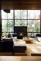 In winter the open plan living area is heated with a fuel efficient wood-burning stove