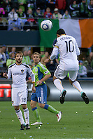 Landon Donovan(10) of the LA Galaxy heads the ball to teammate Mike Magee (18) as Jeff Parke(31) of the Seattle Sounders defends in the first game of the 2010 MLS Playoffs at the XBox 360 Pitch at Quest Field in Seattle, WA on October 31, 2010. The Galaxy defeated the Sounders 1-0.