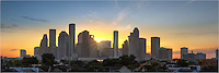 On a mild September morning, the Houston skyline awakens in this panorama image captured at the moment the sun peeked over downtown. This image is a stitch of several photographs and attempts to capture the cityscape at dawn. <br />