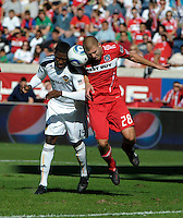 LA Galaxy forward Edson Buddle (14) and Chicago defender Steven Kinney (28) trap the ball against their heads.  The LA Galaxy tied the Chicago Fire 1-1 at Toyota Park in Bridgeview, IL on September 4, 2010