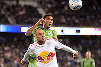 Joel Lindpere (20) of the New York Red Bulls holds off James Riley (7) of the Seattle Sounders during the first half. The New York Red Bulls defeated the Seattle Sounders 1-0 during a Major League Soccer (MLS) match at Red Bull Arena in Harrison, NJ, on March 19, 2011.