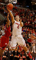 Ohio State Buckeyes guard Aaron Craft (4) scores against Nebraska Cornhuskers guard Ray Gallegos (15) in the second half at Value City Arena in Columbus Jan. 4, 2013 (Dispatch photo by Eric Albrecht)