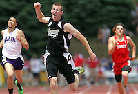 Grand Island Northwest's Cody Rush celebrates crossing the finish line first in the Class B boys 400 meter dash at the 2011 NSAA state track and field championships on Saturday at Omaha Burke Stadium. (Independent/Crystal LoGiudice)..
