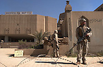 U.S. 3rd Battallion 7th Marines stand guard at the Iraqi Ministry of Oil building April 11, 2003 in downtown Baghdad, Iraq. At the time, power and water services to the city had been out for several weeks and the United States military said that their immediate restoration was a top priority.