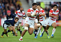 Amanaki Mafi of Japan goes on the attack. Rugby World Cup Pool B match between Scotland and Japan on September 23, 2015 at Kingsholm Stadium in Gloucester, England. Photo by: Patrick Khachfe / Onside Images