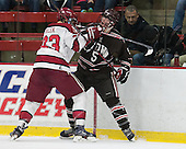 David Valek (Harvard - 23), Tyler Wood (Brown - 5) - The visiting Brown University Bears defeated the Harvard University Crimson 2-0 on Saturday, February 22, 2014 at the Bright-Landry Hockey Center in Cambridge, Massachusetts.
