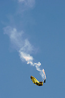 Paraglider performing over Voss.The Extremesport Week, Ekstremsportveko, is the worlds largest gathering of adrenalin junkies. In the small town of Voss enthusiasts in a varitety of extreme sports come togheter every summer to compete and play. Norway..©Fredrik Naumann/Felix Features.