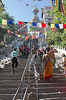 Kathmandu, Nepal.  Stairs Leading to the Swayambhunath Temple.  A shorter climb can be made from a car park on the other side of the temple hilltop, but the devout usually approach via this steeper climb.  Prayer flags hang over the walkway.
