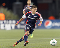 New England Revolution midfielder Kelyn Rowe (11) on the attack.  In a Major League Soccer (MLS) match, the New England Revolution (blue) defeated Columbus Crew (white), 3-2, at Gillette Stadium on October 19, 2013.