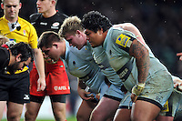 The Worcester Warriors front row of Joe Rees, Niall Annett and Na'ama Leleimalefaga prepare to scrummage. Aviva Premiership match, between Saracens and Worcester Warriors on November 28, 2015 at Twickenham Stadium in London, England. Photo by: Patrick Khachfe / JMP