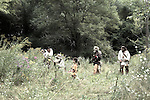 Mountainmen trappers and a Native American Indian boy go hunting