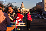 People wander along Pennsylvania Avenue ahead of Monday's inauguration of President Barack Obama on Sunday, January 20, 2013 in Washington, DC.