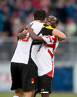 Jake Pace (20) of Maryland celebrates with teammate Chris Odoi-Atsem (28) after the ACC Finals at the Maryland SoccerPlex in Boyds, MD.  Maryland defeated Virginia, 1-0, to win the title.