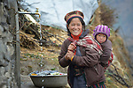 A woman and child obtain water at a communal tap in the village of Gatlang, in the Rasuwa District of Nepal near the country's border with Tibet.<br /> <br /> In the aftermath of the April 2015 earthquake that ravaged Nepal, the ACT Alliance helped people in this village with a variety of services, including blankets, shelter and livelihood assistance.