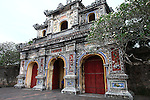 An elaborately decorated gate at the Citadel in the former imperial capital of Hue, Vietnam. Built in 1804, the Citadel was styled after the Forbidden City in Beijing, and was home to the ruling Nguyen dynasty until 1945, when the last emperor, Bao Dai, abdicated. Heavy fighting took place in the Citadel during the Tet Offensive of 1968, and many of its buildings were destroyed. Restoration efforts are ongoing. April 21, 2013.