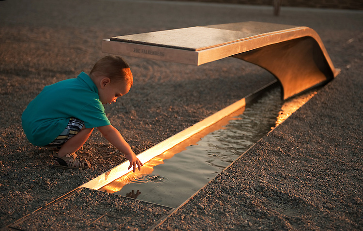 UNITED STATES - SEPTEMBER 01:  Oskar Poltorak, 16 months, of Poland, checks out a bench at the Pentagon Memorial dedicated to Zoe Falkenberg, an 8-year-old who died when American Airlines Flight 77 crashed into Pentagon on 9/11/01.  The memorial, outside of the Pentagon in Arlington Va., has a bench dedicated to each of the 184 people that died in the Pentagon and aboard Flight 77. (Photo By Tom Williams/Roll Call)