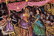 Orlando, Florida - Circa 1986. Disney World characters Cinderella and Jasmine on board a float at the Main Street Electrical Parade. The Main Street Electrical Parade was created by Bob Jani and Ron Miziker, and first appeared at Disney World on June 11, 1977. Disney World is a world-renowned entertainment complex that opened October 1, 1971 in Lake Buena Vista, FL. Now known as the Walt Disney World Resort, the property covers 25,000 acres and has an annual attendance of 52.5million people.